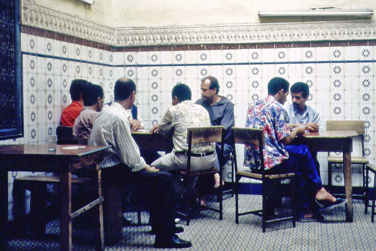 Men playing cards in a restaurant