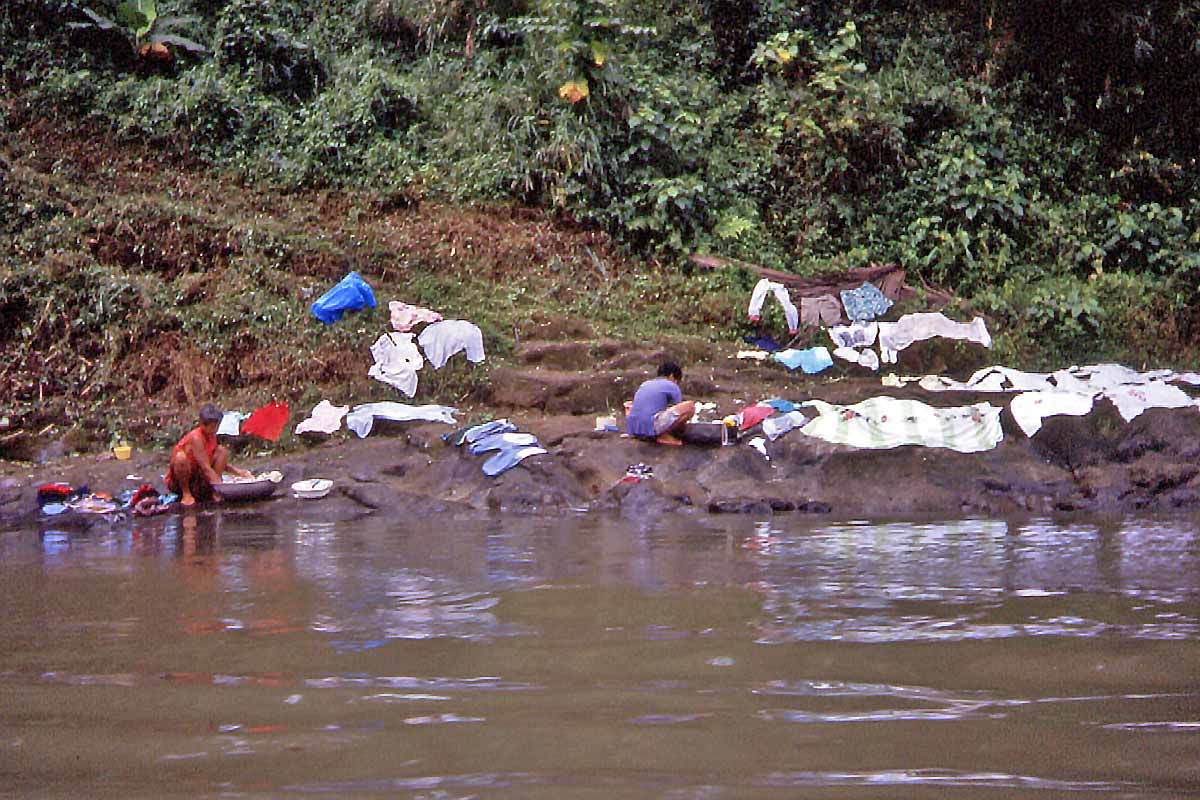 philippine women are washing at the river