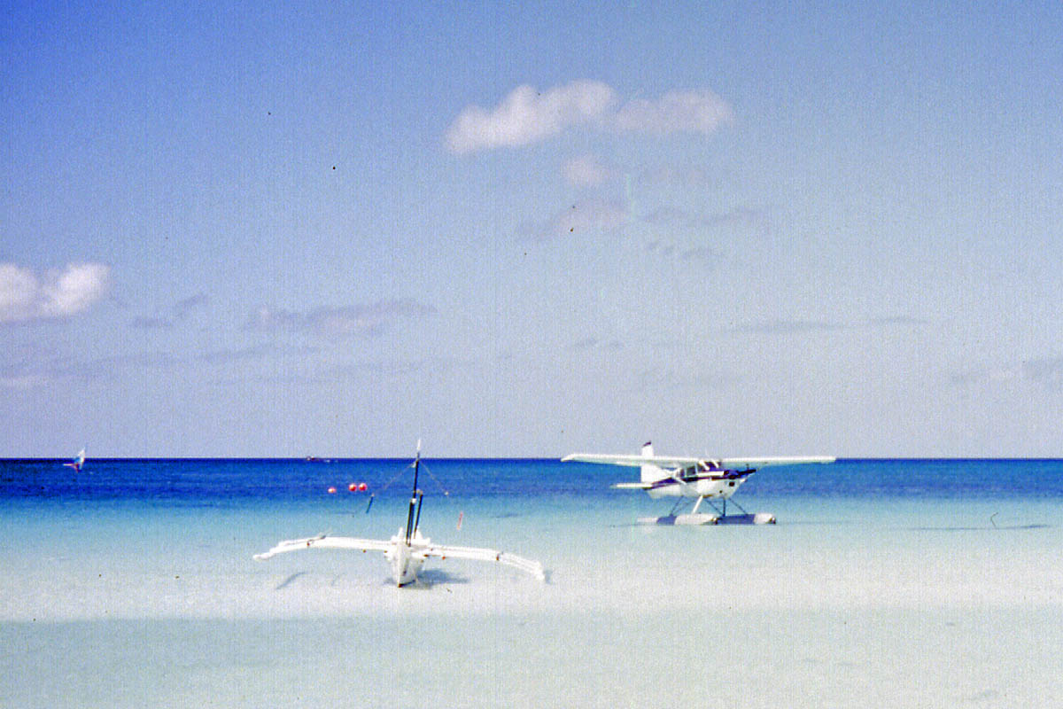 plane and boat on boracay beach